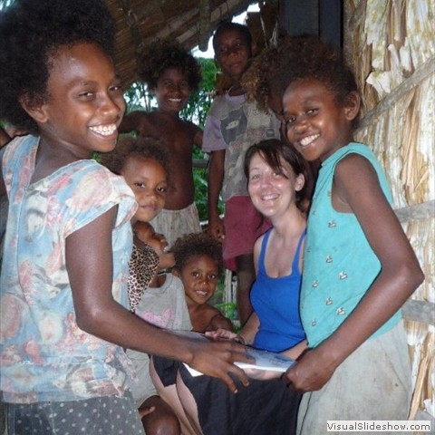 20. Tammy working with  children in the village